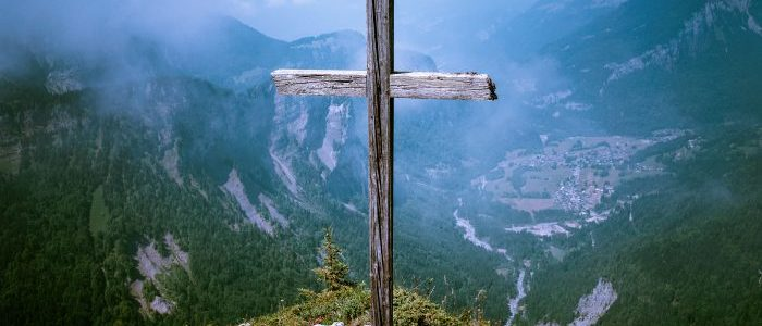 wooden cross on mountain